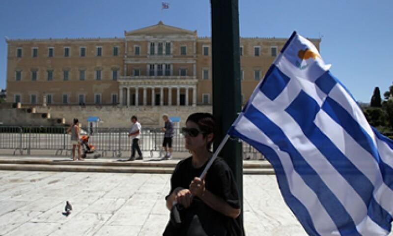 El organismo instó a Grecia a fortalecer la independencia de la administración tributaria. (Foto: AP)