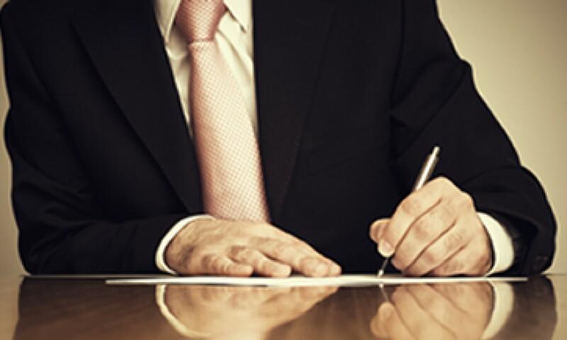 Las firmas de Carlos Slim, Scott Rank, Marcos Martínez y Alberto Bailléres tienen en común la letra de molde. Las curvas en éstas revelan la capacidad y facilidad que poseen para los negocios y el dinero. (Foto: Getty Images)