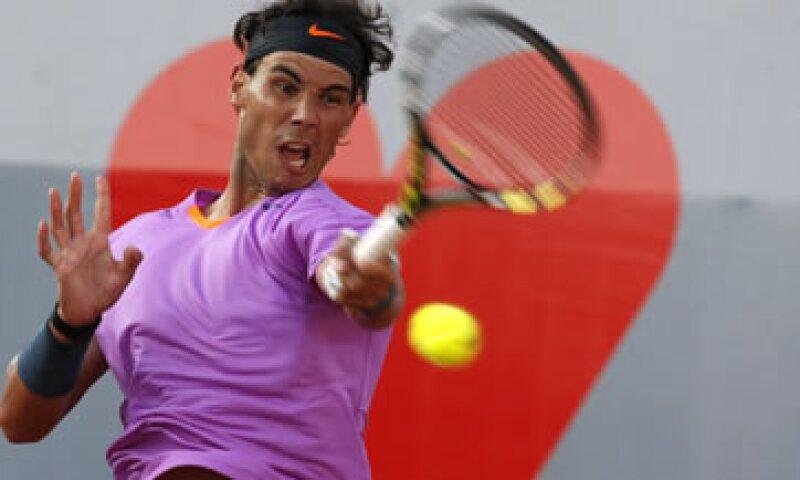 Rafael Nadal tiene el sitio 16 en la lista de los deportistas mejor pagados, según Forbes. (Foto: AP)