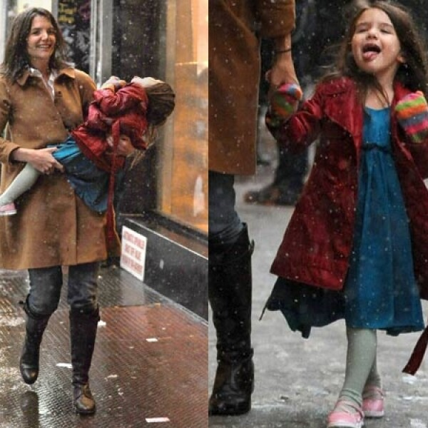 Suri demuestra que le gusta la nieve mientras pasea con mamá.