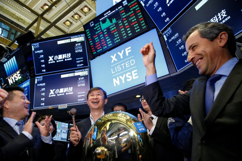 Shaoyong (Simon) Cheng, president of X Financial, a Chinese technology and personal finance company, rings a ceremonial bell to start trading the company's stock during the company's IPO at the NYSE in New York
