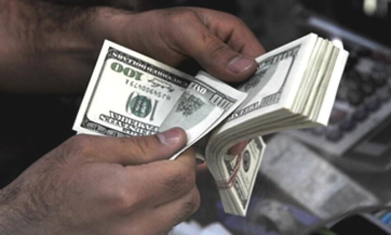 El dólar podría oscilar este lunes entre 12.70 y 12.79 pesos por dólar.  (Foto: Getty Images)