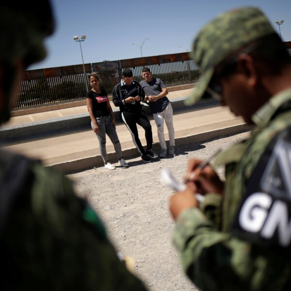 FILE PHOTO: Members of Mexico's National Guard detain Cuban migrants after they were trying to cross illegally the border between the U.S. and Mexico, in Ciudad Juarez