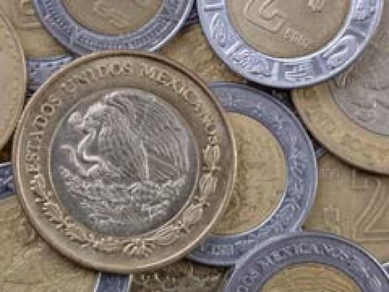 El tipo de cambio cerró la jornada de este martes con ganancias frente al peso. (Archivo)