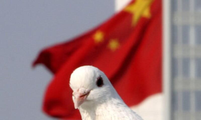 China tiene espacio para liberar un nuevo estímulo fiscal si es golpeado por la crisis económica de Europa y EU, considera el FMI. (Foto: AP)