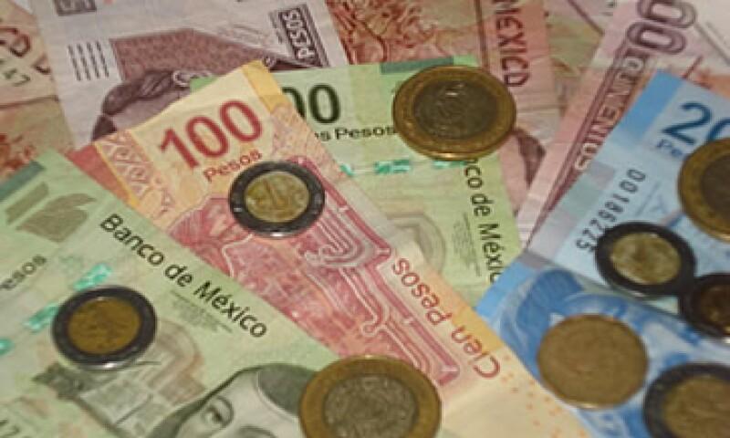 La moneda mexicana operaba en 11.54 por dólar a la compra en ventanillas de bancos y casas de cambio. (Foto: Karina Hernández)