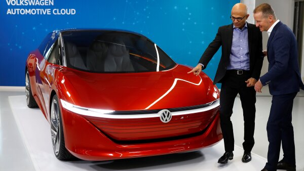 Microsoft CEO Satya Nadella and Volkswagen CEO Herbert Diess address a news conference in Berlin
