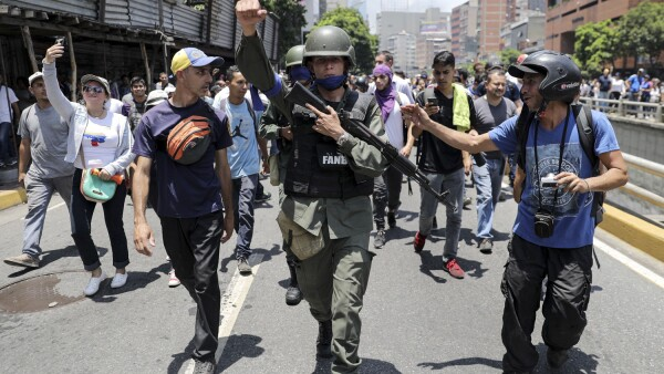 Venezuelan National Guard (GNB) members join protesters in Caracas