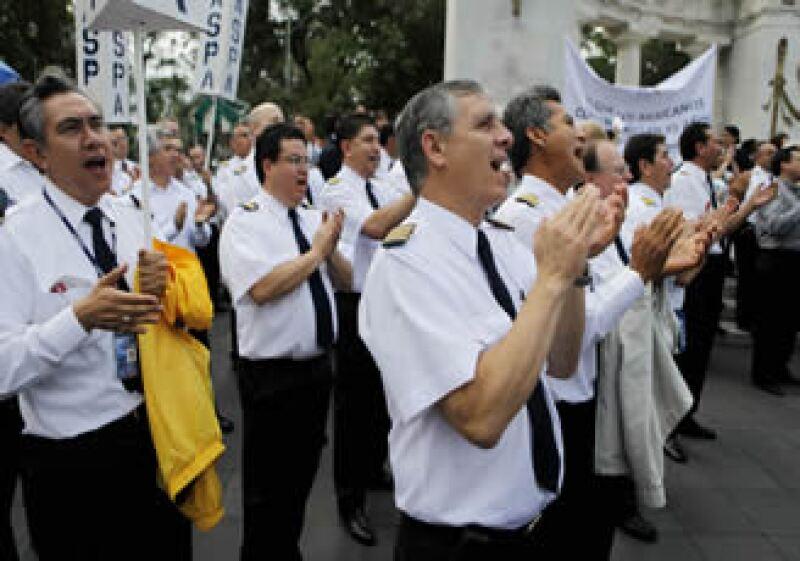 Los pilotos negocian con PC Group un nuevo contrato colectivo de trabajo y los pasivos laborales. (Foto: AP)