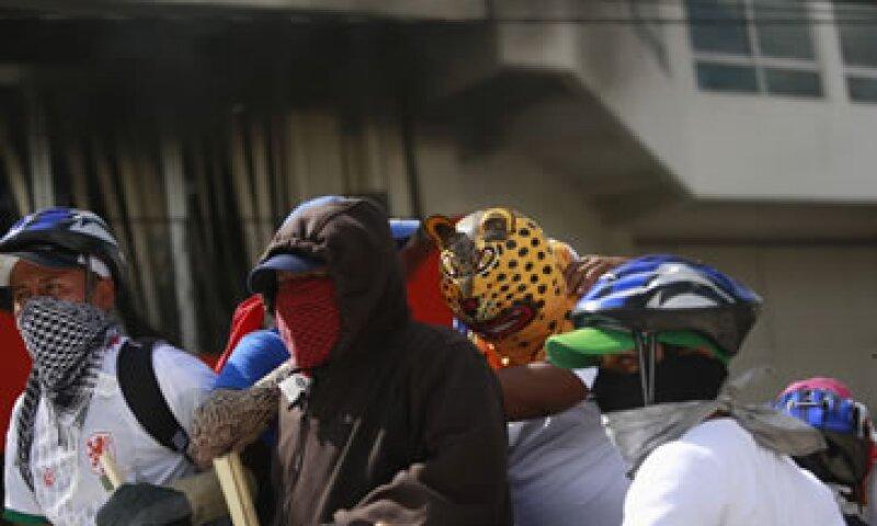 FEMSA confirmó afectaciones por las protestas y dijo que busca garantizar la integridad de sus empleados. (Foto: Especial )