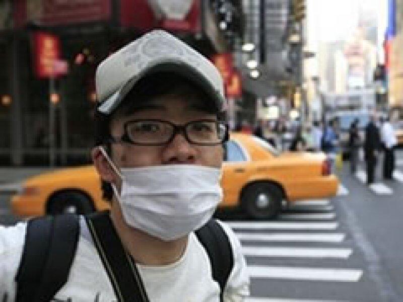En Nueva York, la población se protege del contagio de la influenza. (Foto: AP)