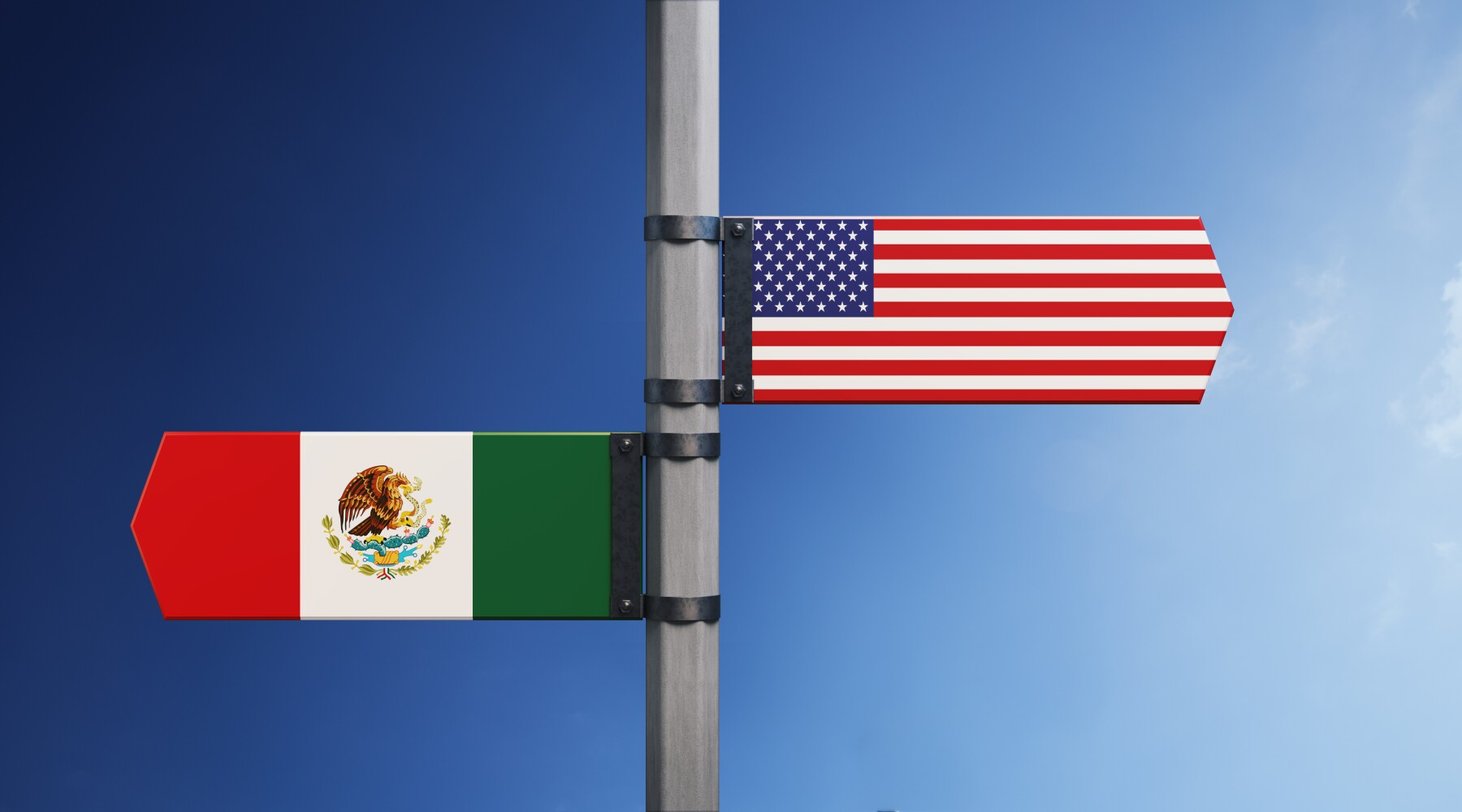 American And Mexican Flag Pair On Road Sign