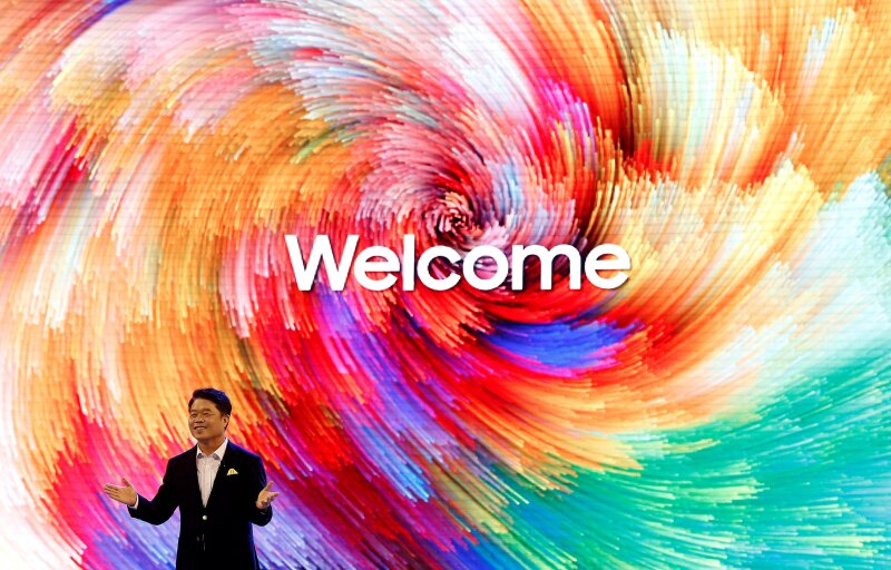 HC Hong, President and CEO, Samsung Electronics SouthWest Asia gestures as he speaks during the opening of a Samsung store in Bengaluru