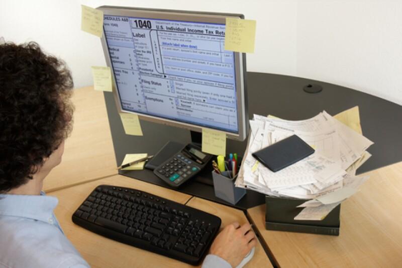 Los comprobantes fiscales digitales reducen costos empezando por el papel. (Foto: Dreamstime)