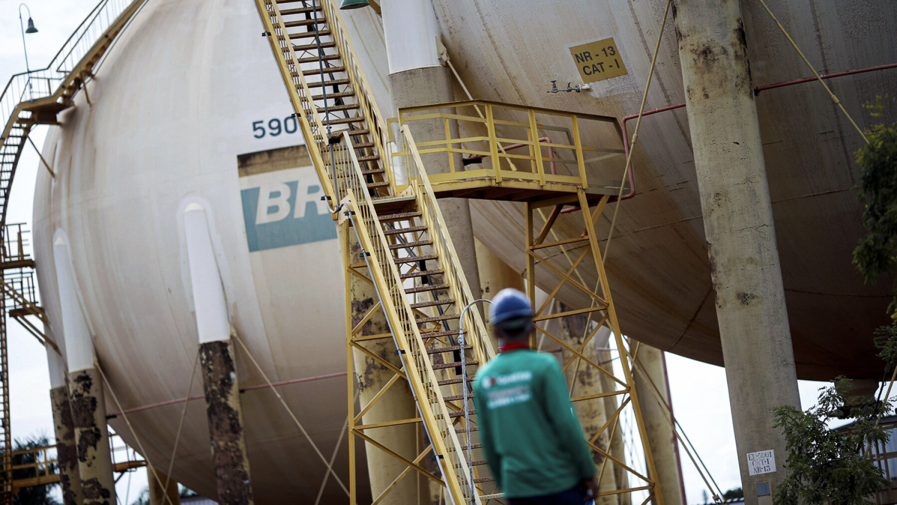 A worker stands near a tank of Brazil's state-run Petrobras oil company in Brasilia
