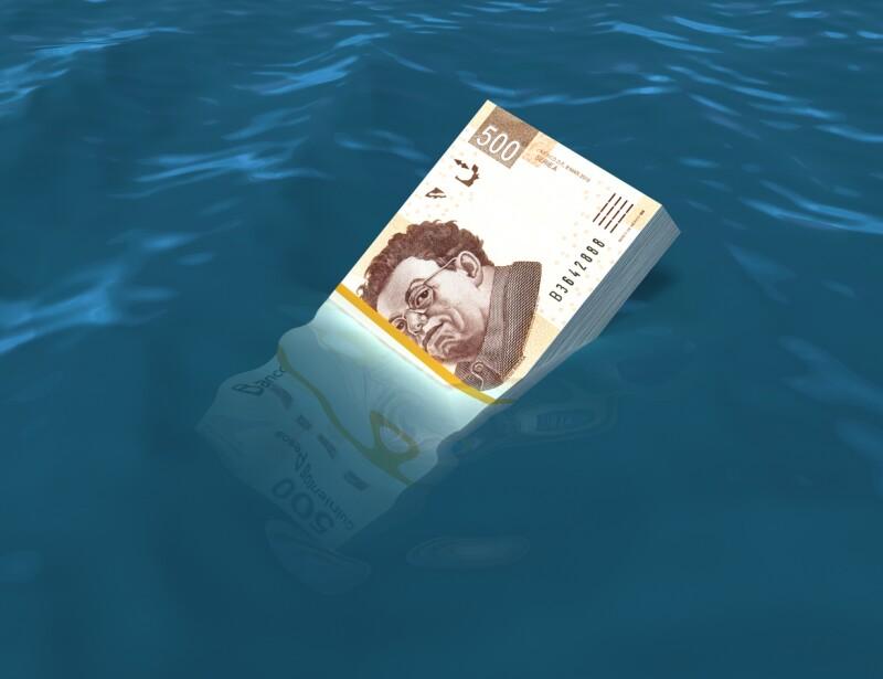 Money sinking in water