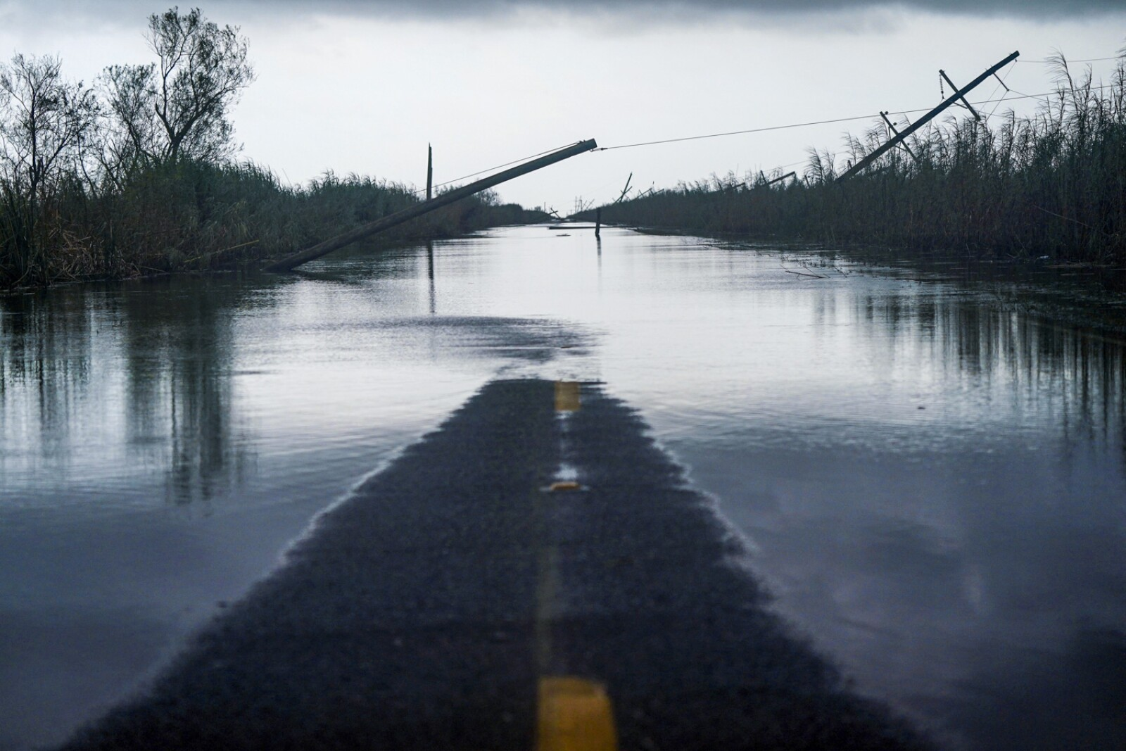 Downed power lines and flooding is seen after Hurricane Laura passed through the area in Creole