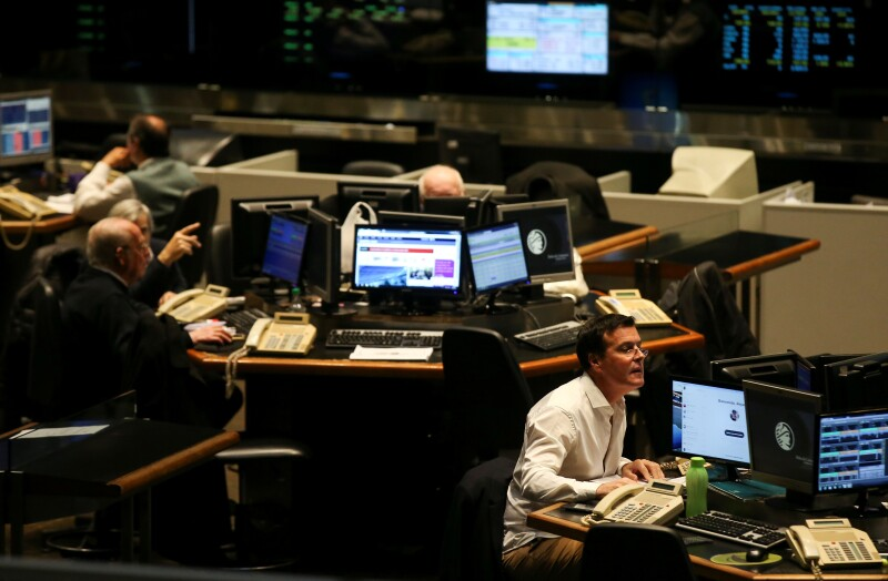 Traders work on the floor of the Buenos Aires Stock Exchange