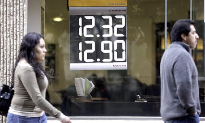 El Banco de México (Banxico) fijó el tipo de cambio en 12.6833 pesos. (Foto: Notimex)