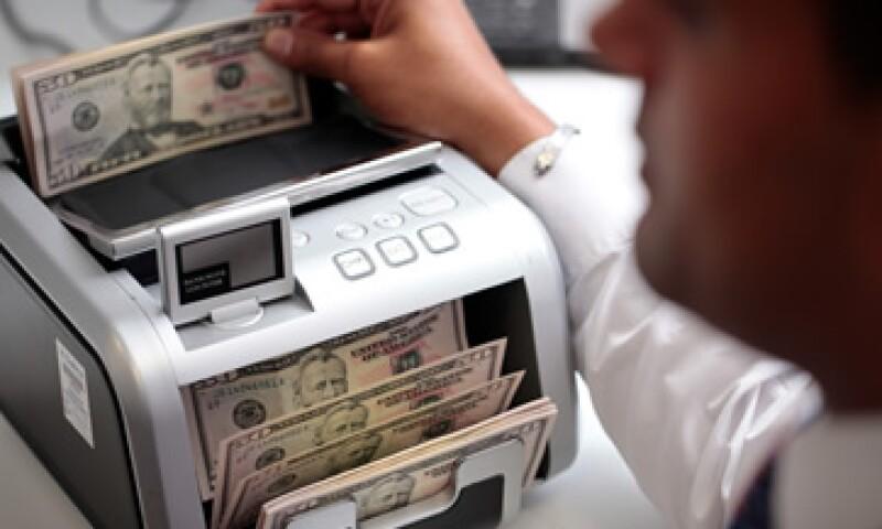 Banco Base estima que este lunes el tipo de cambio se ubique en un rango de 12.76 y 12.84 pesos.  (Foto: Getty Images)