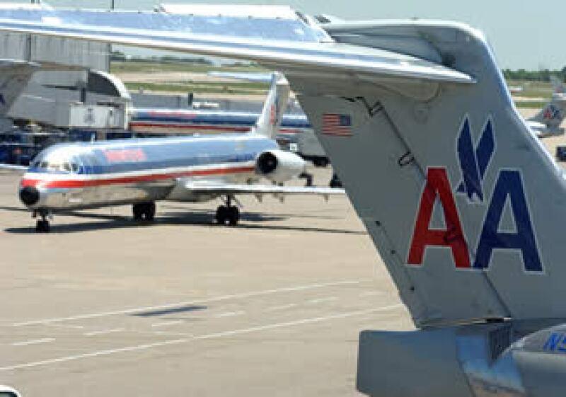 American Airlines fue una de las últimas firmas en aplicar un cargo al equipaje. (Foto: AP)