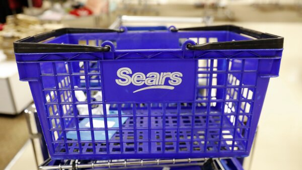 A empty Sears shopping cart is seen inside a store in Brooklyn, New York