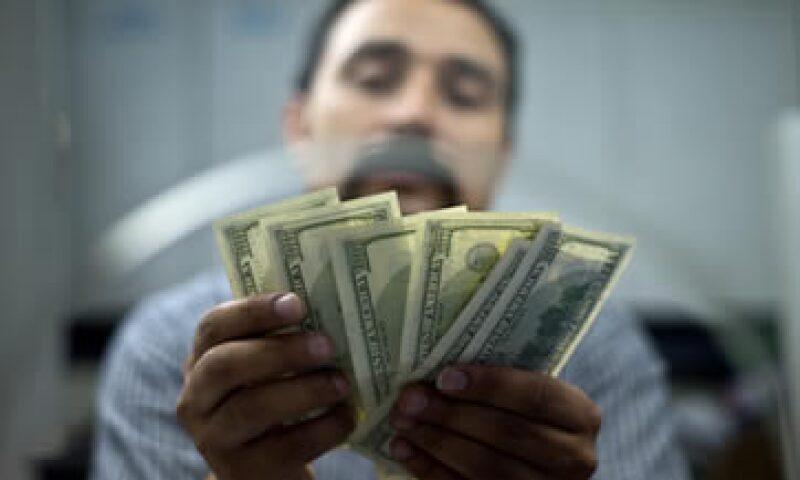 El tipo de cambio para solventar obligaciones denominadas en moneda extranjera es de  12.9454 pesos.   (Foto: iStock by Getty Images.)