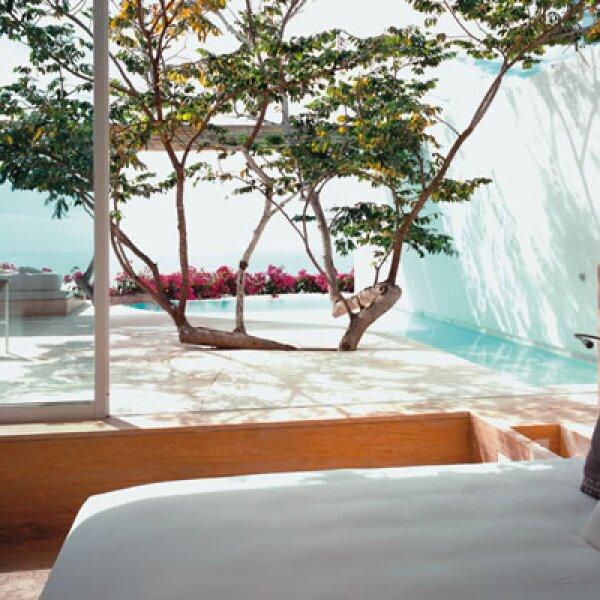 Las habitaciones del Hotel Encanto ofrecen privacidad absoluta, con detalles interiores en cada rincón que estimulan los ojos.