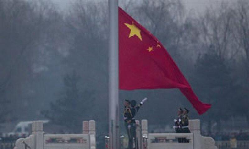 China había elevado los requerimientos de reserva a los bancos para frenar la elevada inflación. (Foto: AP)