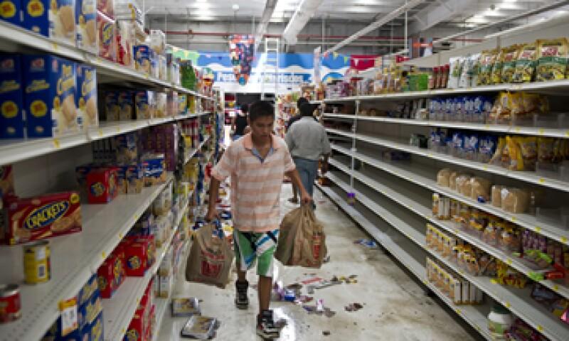 Ahora que las tiendas están prácticamente desvalijadas, los habitantes de unos quince barrios temen que sus casas sean el próximo objetivo. (Foto: AFP)