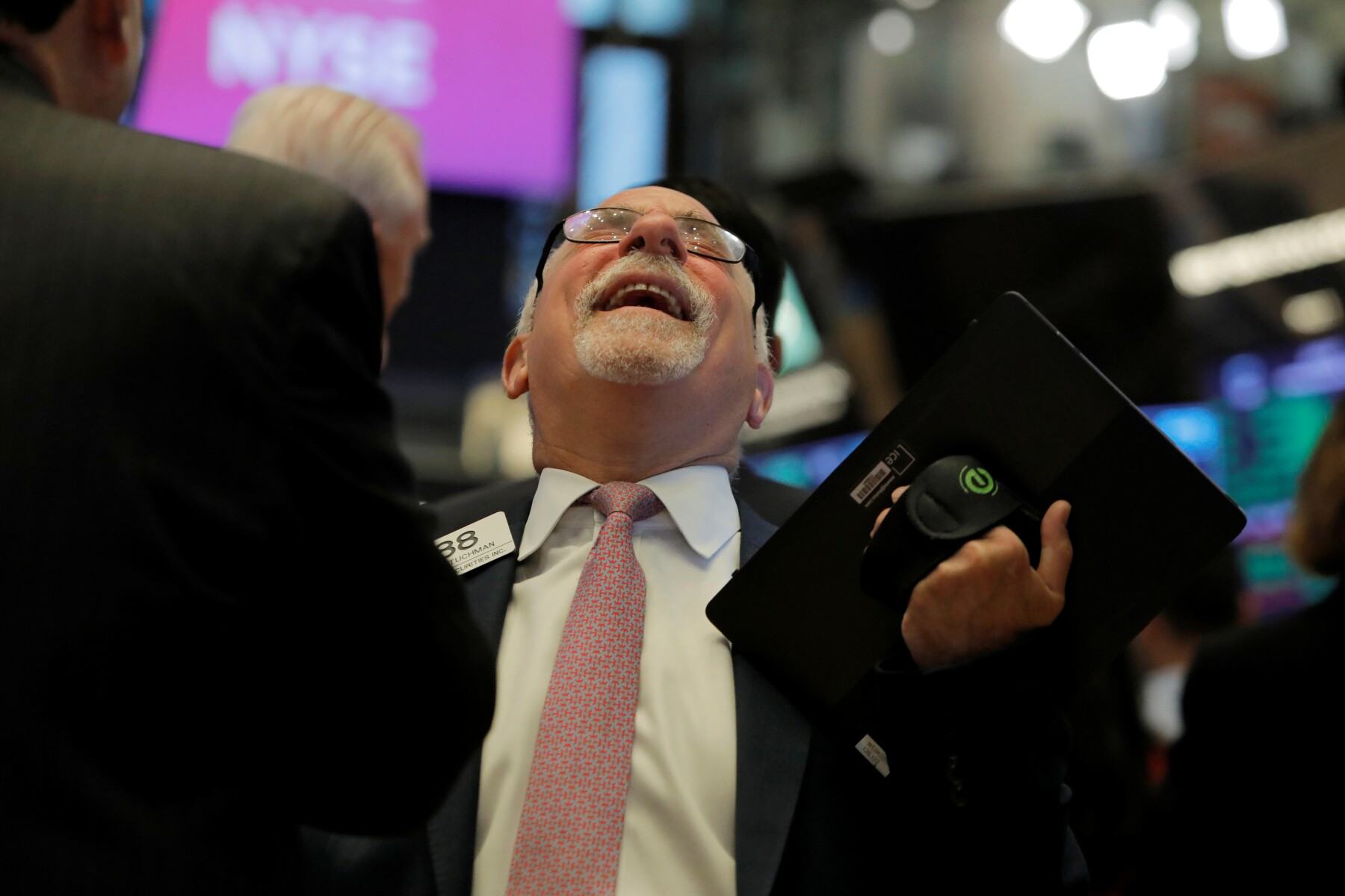 Trader Peter Tuchman reacts during the opening of the market on the trading floor at the New York Stock Exchange (NYSE) in New York City