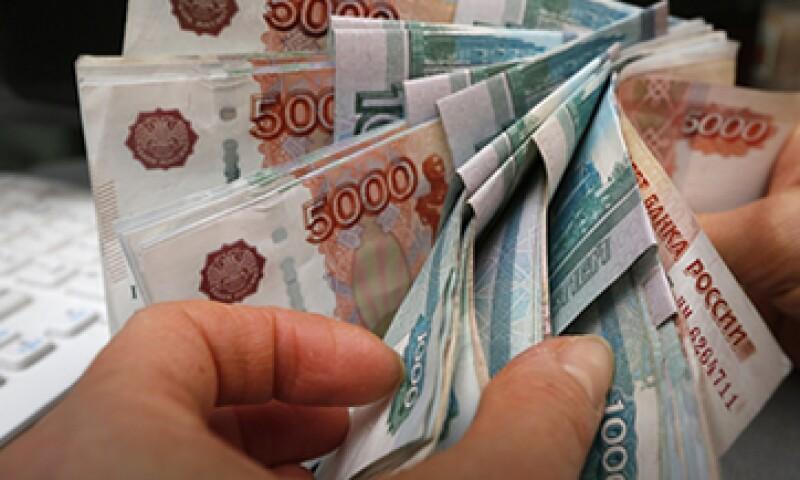 Las sanciones redujeron la cpaacidad de lsa compañías rusas para contraer deuda en el exterior. (Foto: Reuters )