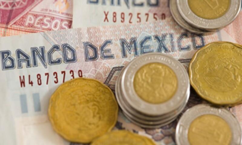 Analistas esperan que el peso cotice entre 12.70 y 12.95 unidades por dólar. (Foto: Getty Images)