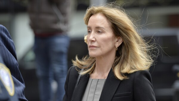 Felicity Huffman expected to plead guilty to using bribery to get daughter into university