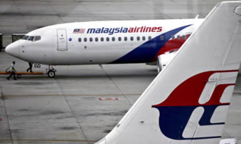 Malaysia Airlines enfrentó una reestructuración que incluyó el despido de 6,000 empleados en 2014. (Foto: EFE )