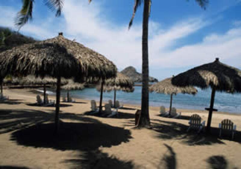 La subsecretaria de Planeación Turística de la Sectur informó que el gasto promedio de los turistas extranjeros cayó 10% en 2009.  (Foto: Jupiter Images)