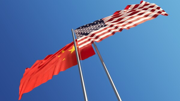 American and Chinese Flags Waving With Wind: Dispute Concept