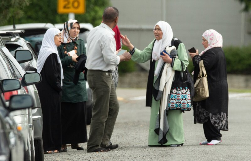 Members of a family react outside the mosque following a shooting at the Al Noor mosque in Christchurch