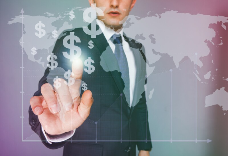 Businessman touching dollar signs on virtual screen