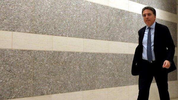Argentine Treasury Minister Nicolas Dujovne talks to the media at the IMF in Washington