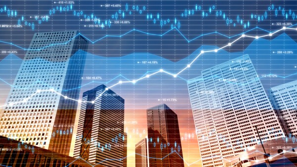 Business district: stock market and finance data on city background