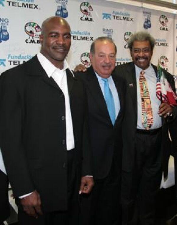 Evander Holyfield, Carlos Slim y Don King.