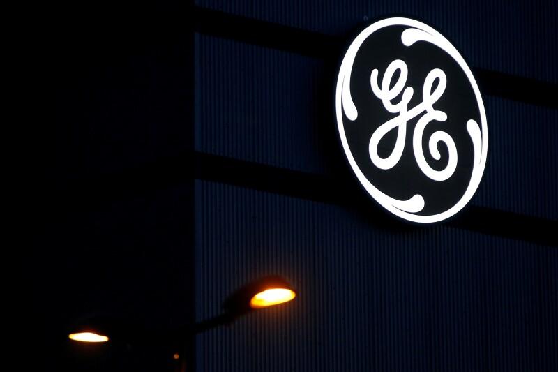 FILE PHOTO: The General Electric logo is pictured on the General Electric offshore wind turbine plant in Montoir-de-Bretagne