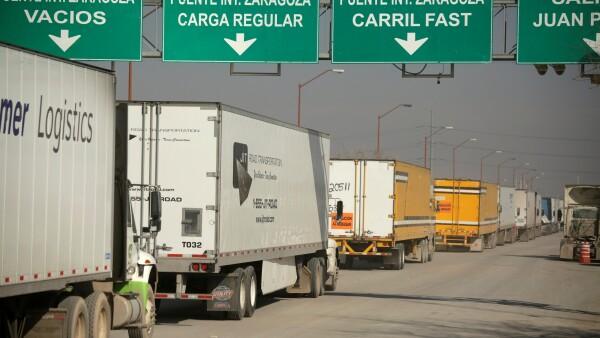 Trucks wait in a queue for border customs control at the Zaragoza-Ysleta border crossing bridge in Ciudad Juarez
