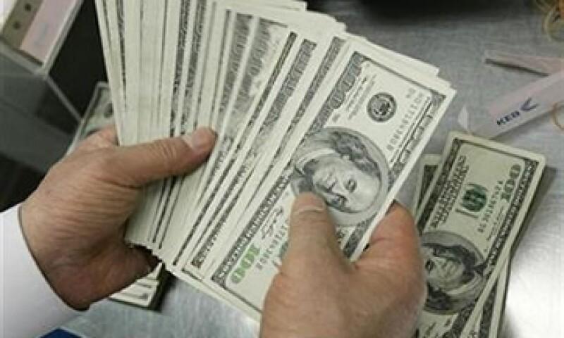 El Banco de México (Banxico) fijó el tipo de cambio en 12.7200 pesos. (Foto: Reuters)