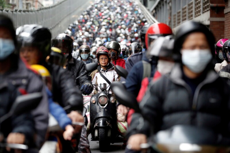 Commuters wear face masks to protect themselves from the coronavirus disease (COVID-19) spread during morning rush hour traffic in Taipei