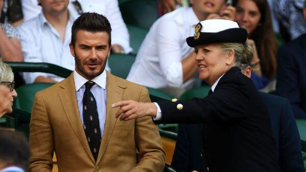 El exfutbolista asistió acompañado de su mamá al Grand Slam.
