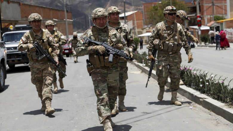 Military members patrol the streets in La Paz
