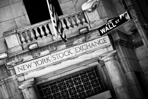New York Stock Exchange entrance with Wall Street sign