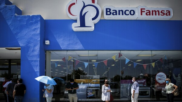 People queue to enter to a branch of Banco Ahorro Famsa, the savings bank arm of retailer Grupo Famsa, in Ciudad Juarez